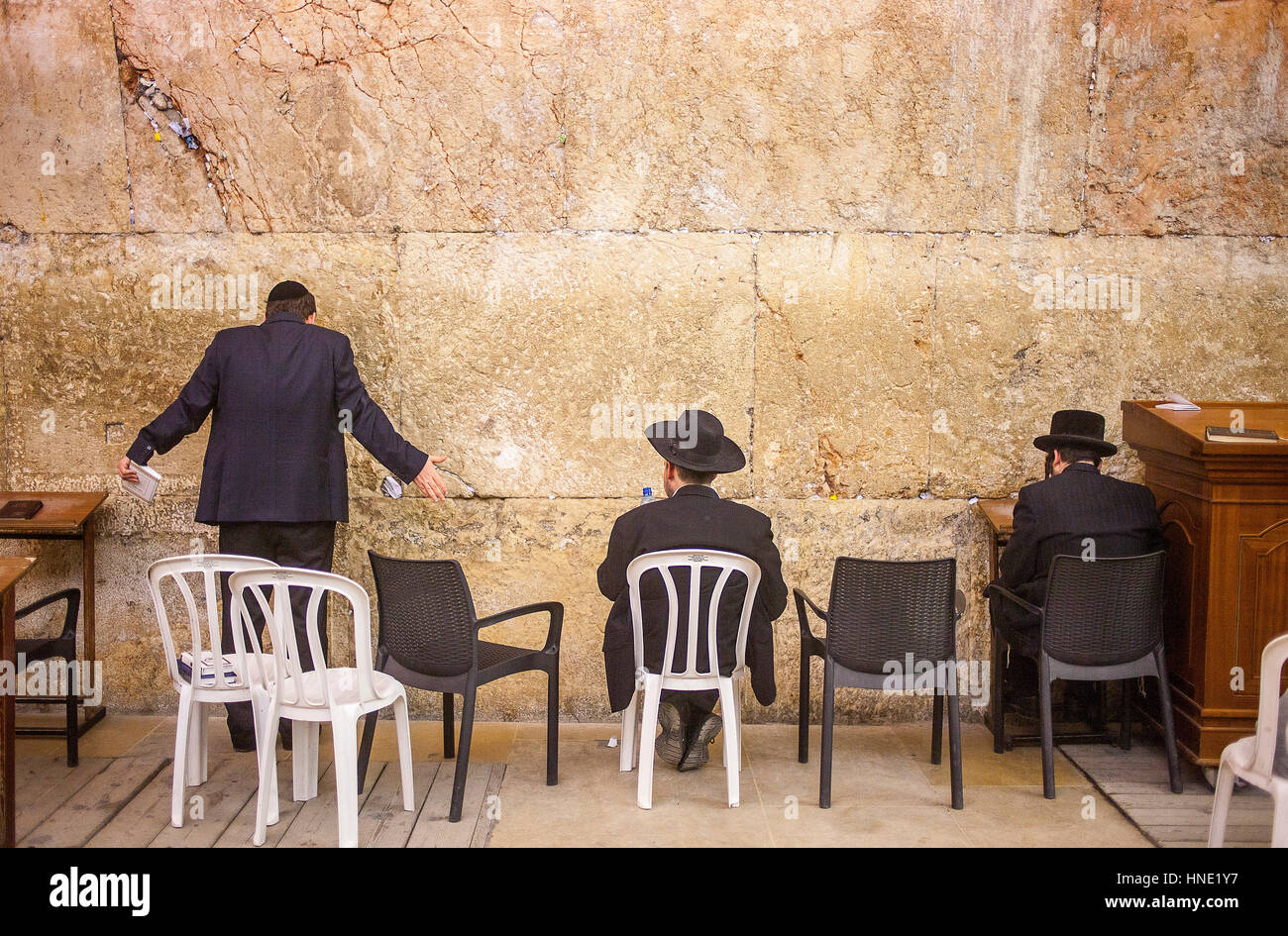 Wailing Wall, men's prayer area, praying at the Western Wall,in Wilson's arch, Jewish Quarter, Old City, - Stock Image