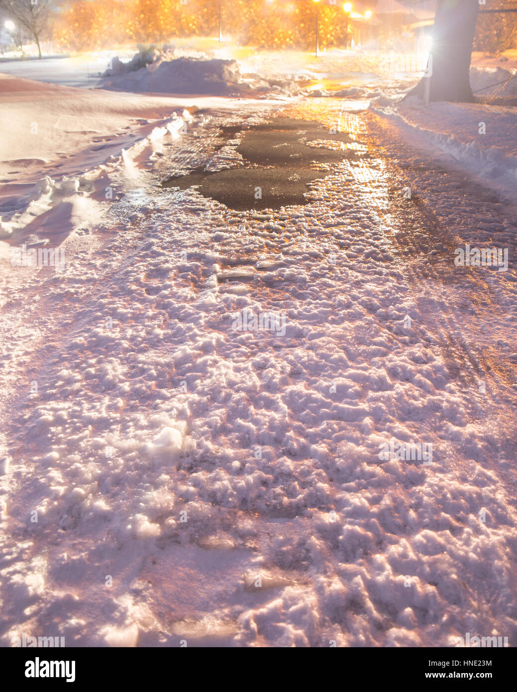Frozen winter road covered in ice and snow - Stock Image