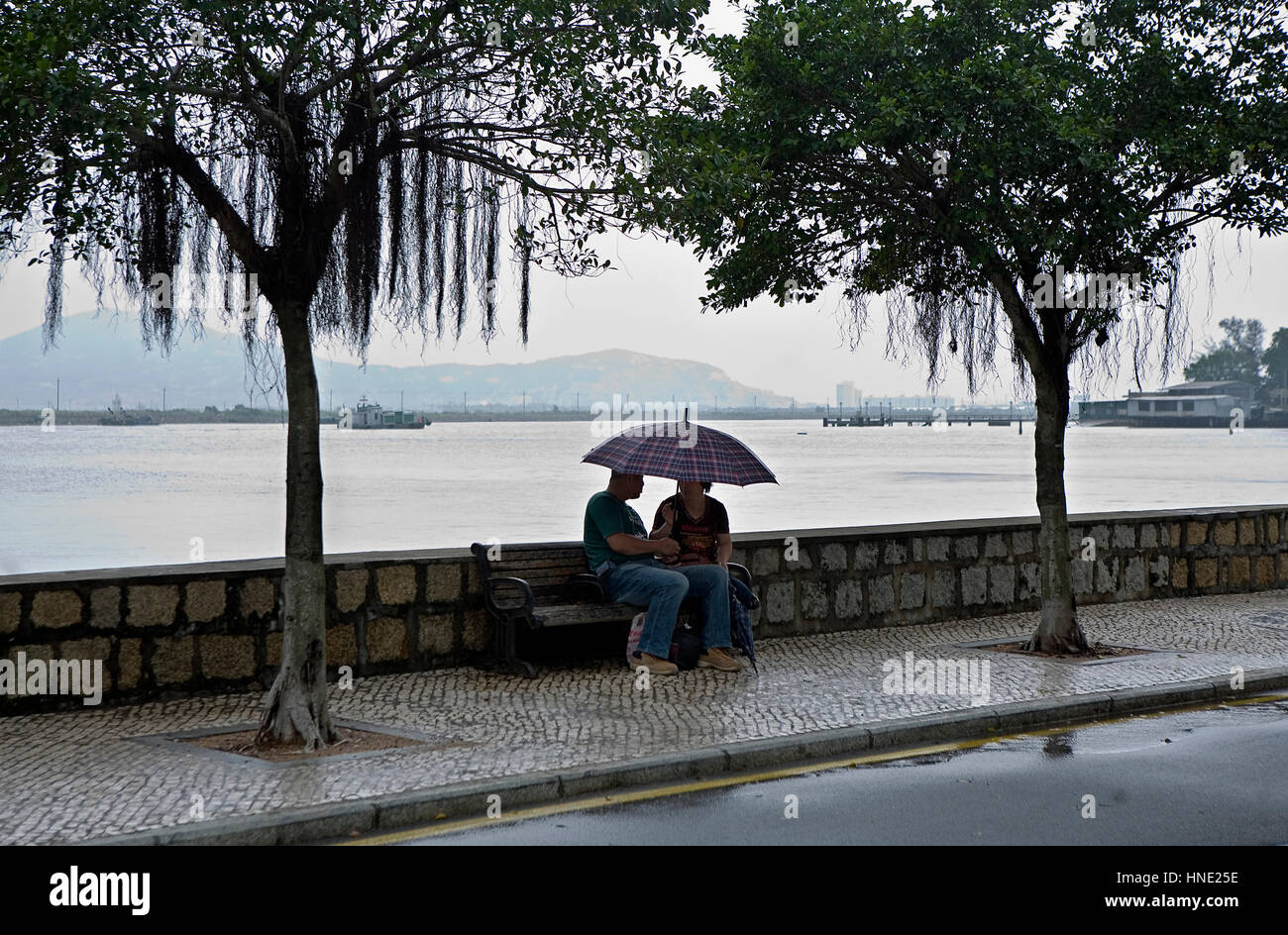 Love, lovers, man and woman, Cinco de Outubro Avenue, Coloane island,Macau,China - Stock Image
