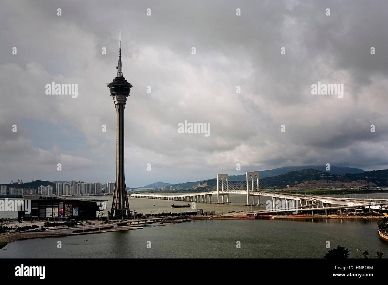 Macau Tower and Sai Van bridge that links Macau to Taipa island,Macau,China - Stock Image
