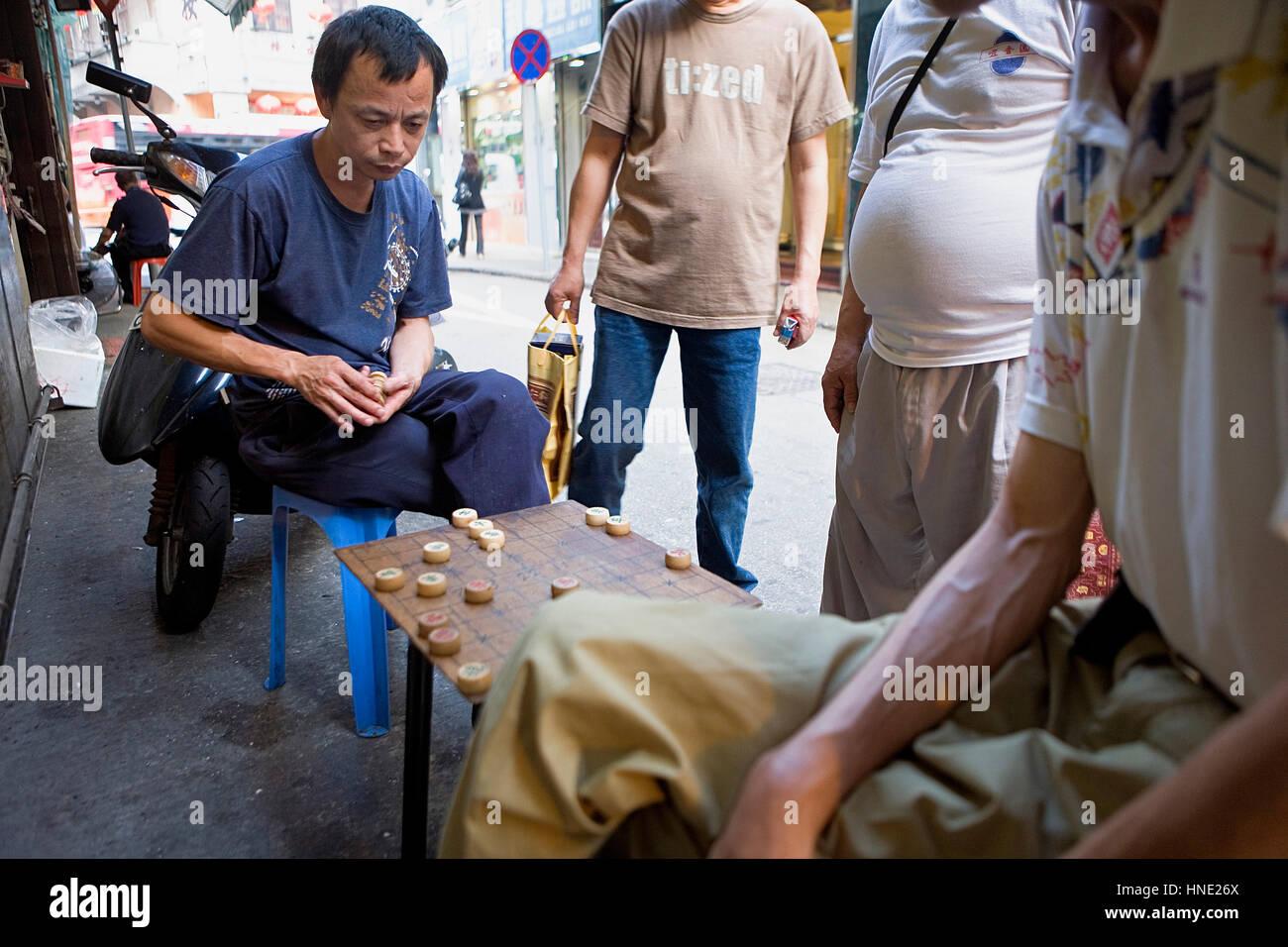 Street scene, Playing chinese chess in Travessa do Matadouro,Macau,China - Stock Image