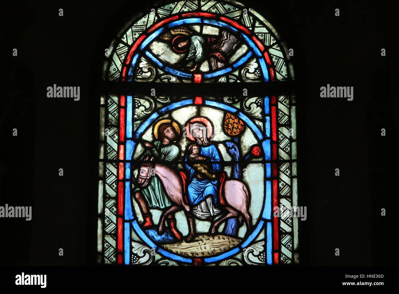 Sacred Heart Basilica. Paray-le-Monial. Stained glass window. La fuite en Egypte. - Stock Image