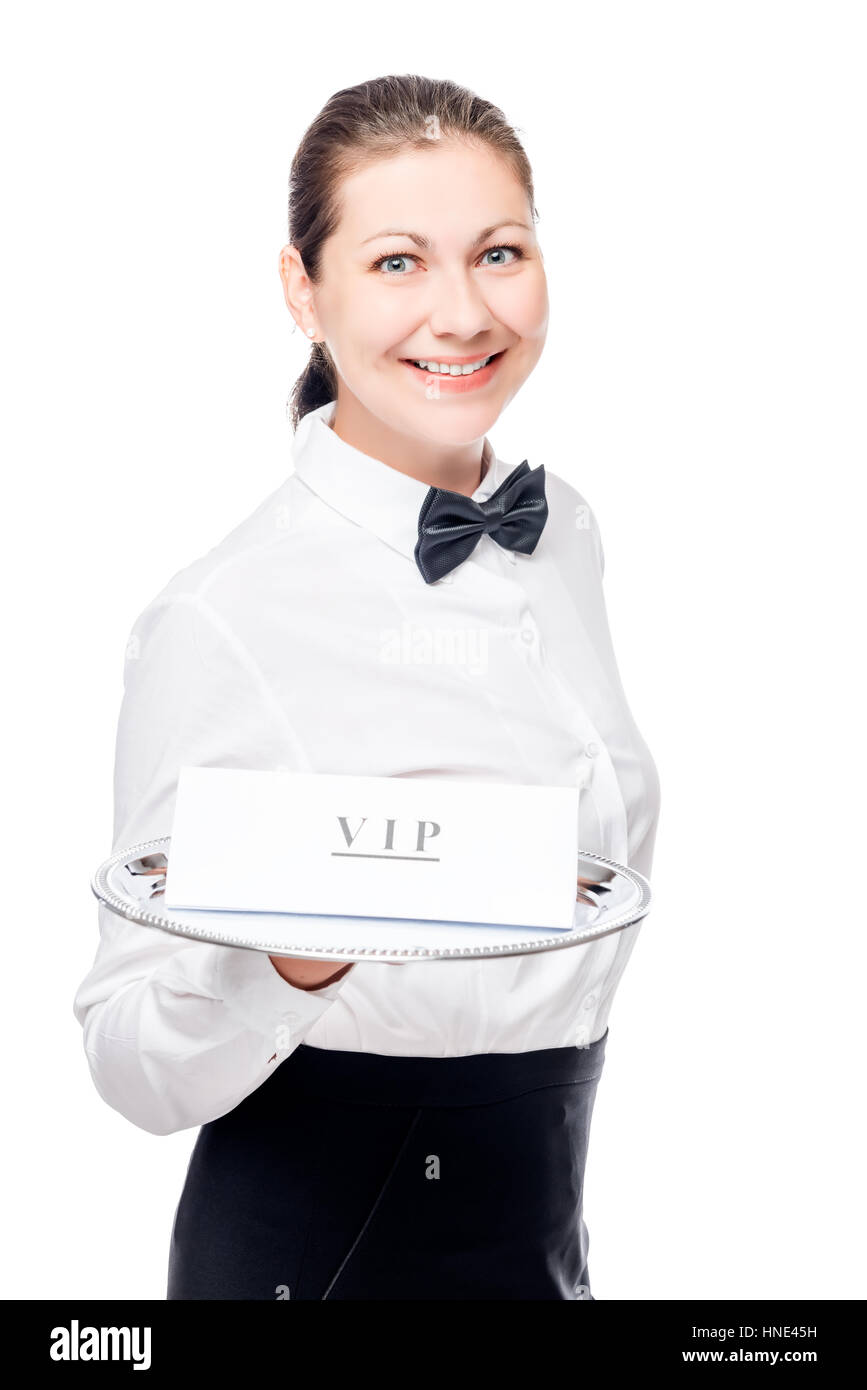 Woman waiter with VIP sign on a tray isolated in the studio - Stock Image