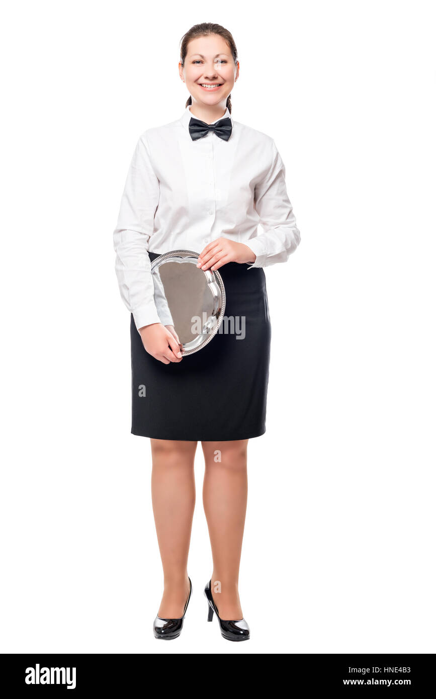 pretty girl waitress with a tray in hands on a white background isolated - Stock Image