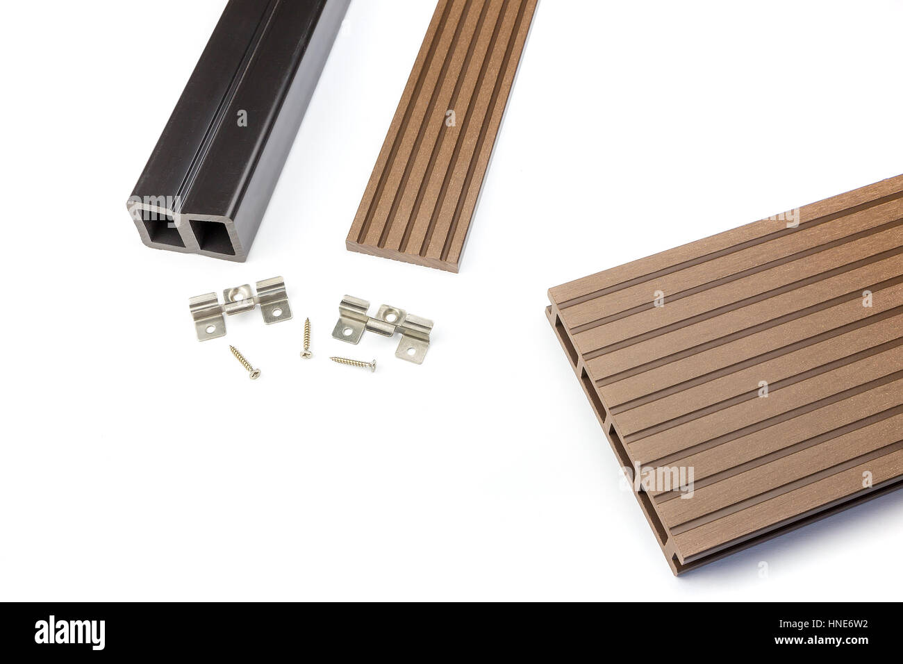 Brown composite decking plank with fastening material - Stock Image