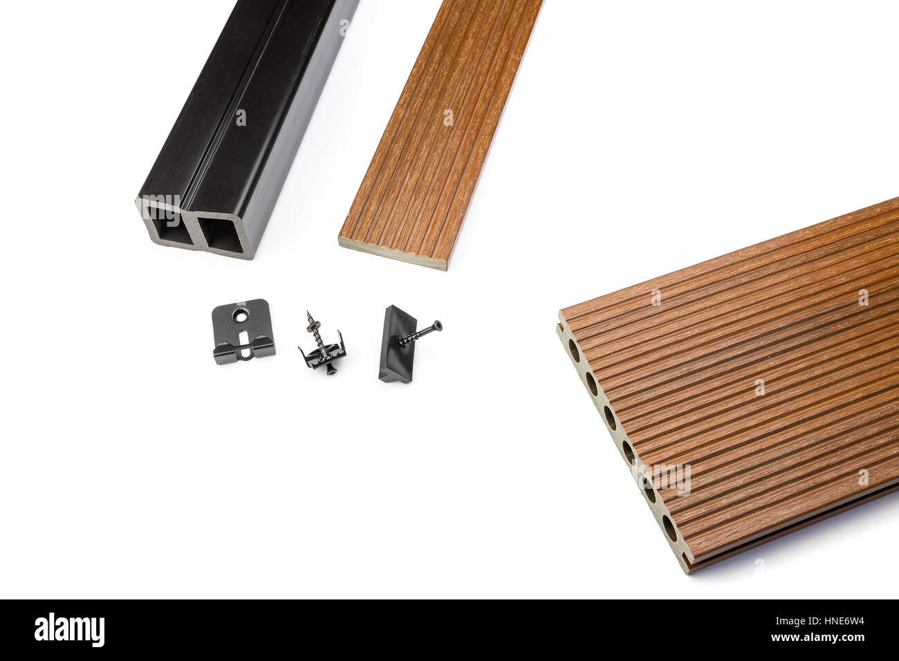 Brown composite decking plank with fastening material on white background - Stock Image