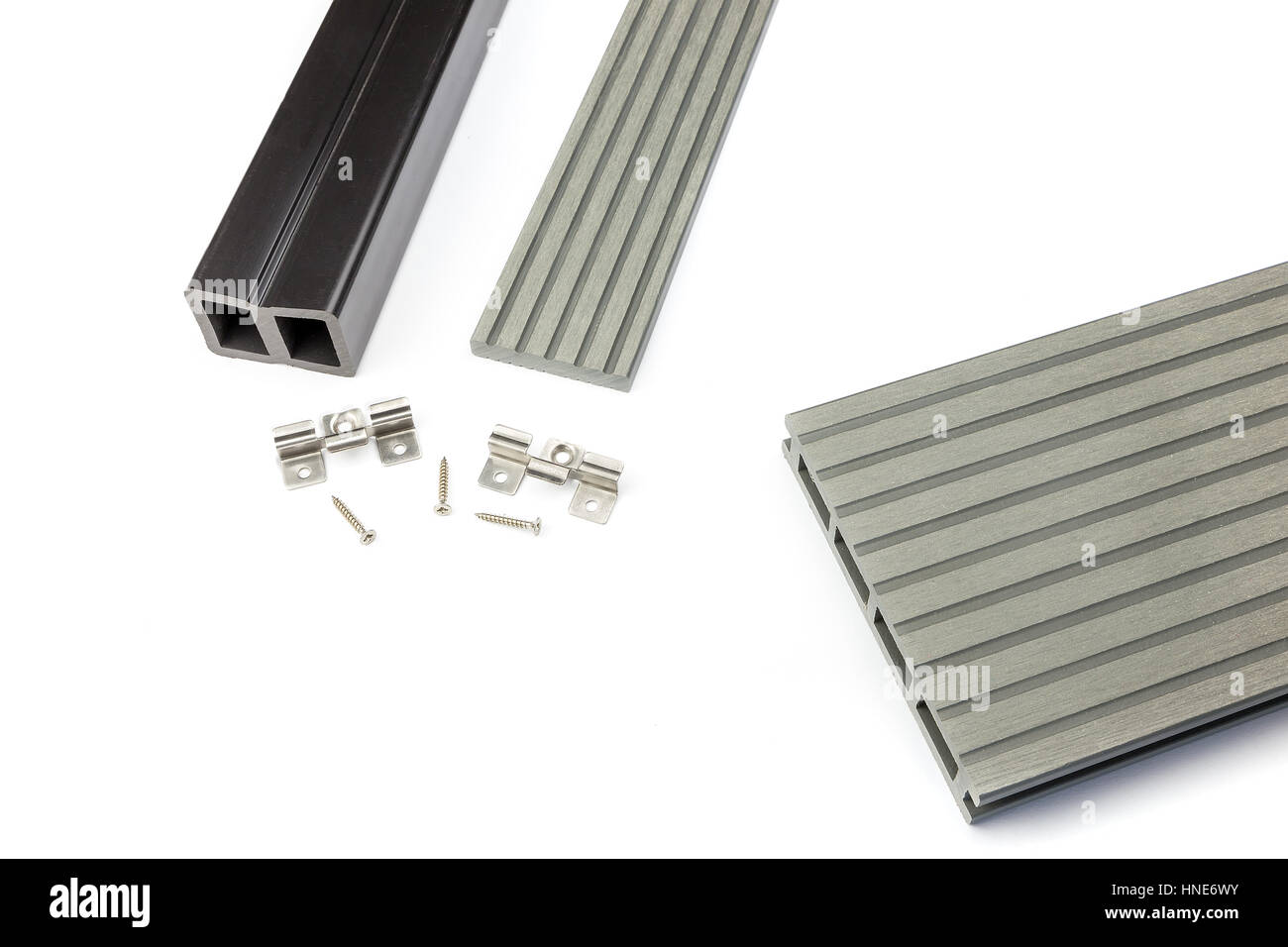 Light grey composite decking plank with fastening material - Stock Image