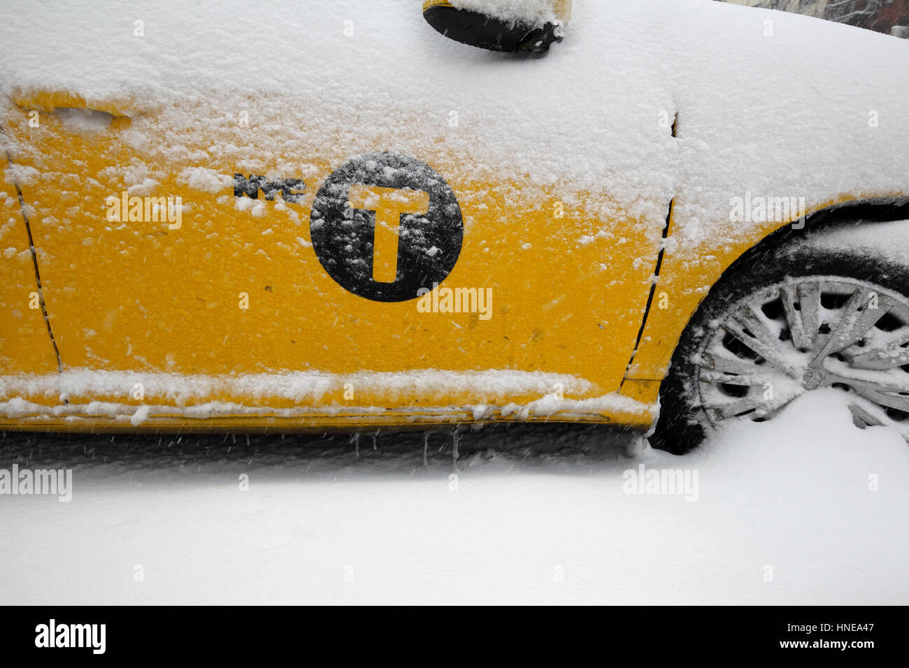 snowed in New York taxi cab - Stock Image