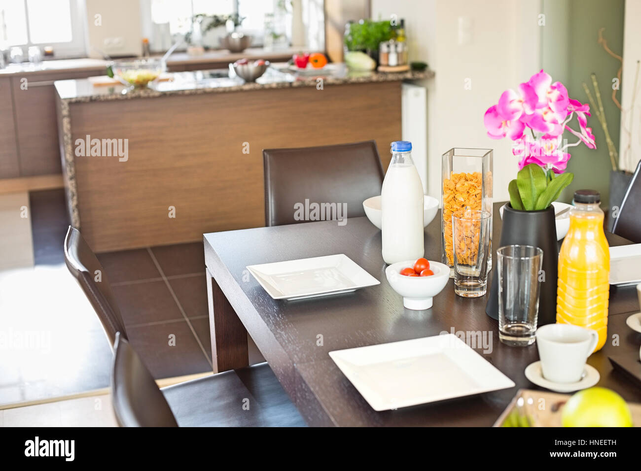 Breakfast on dining table at home - Stock Image