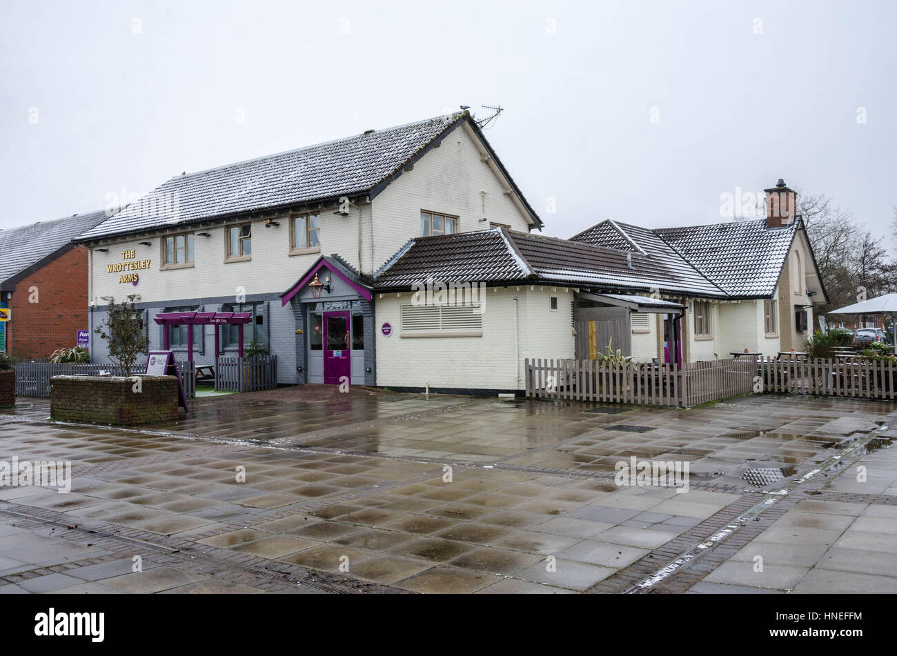 The Wrottesley Arms Pub in Perton, South Staffordshire, seen here with a light covering of snow on it's roof. - Stock Image
