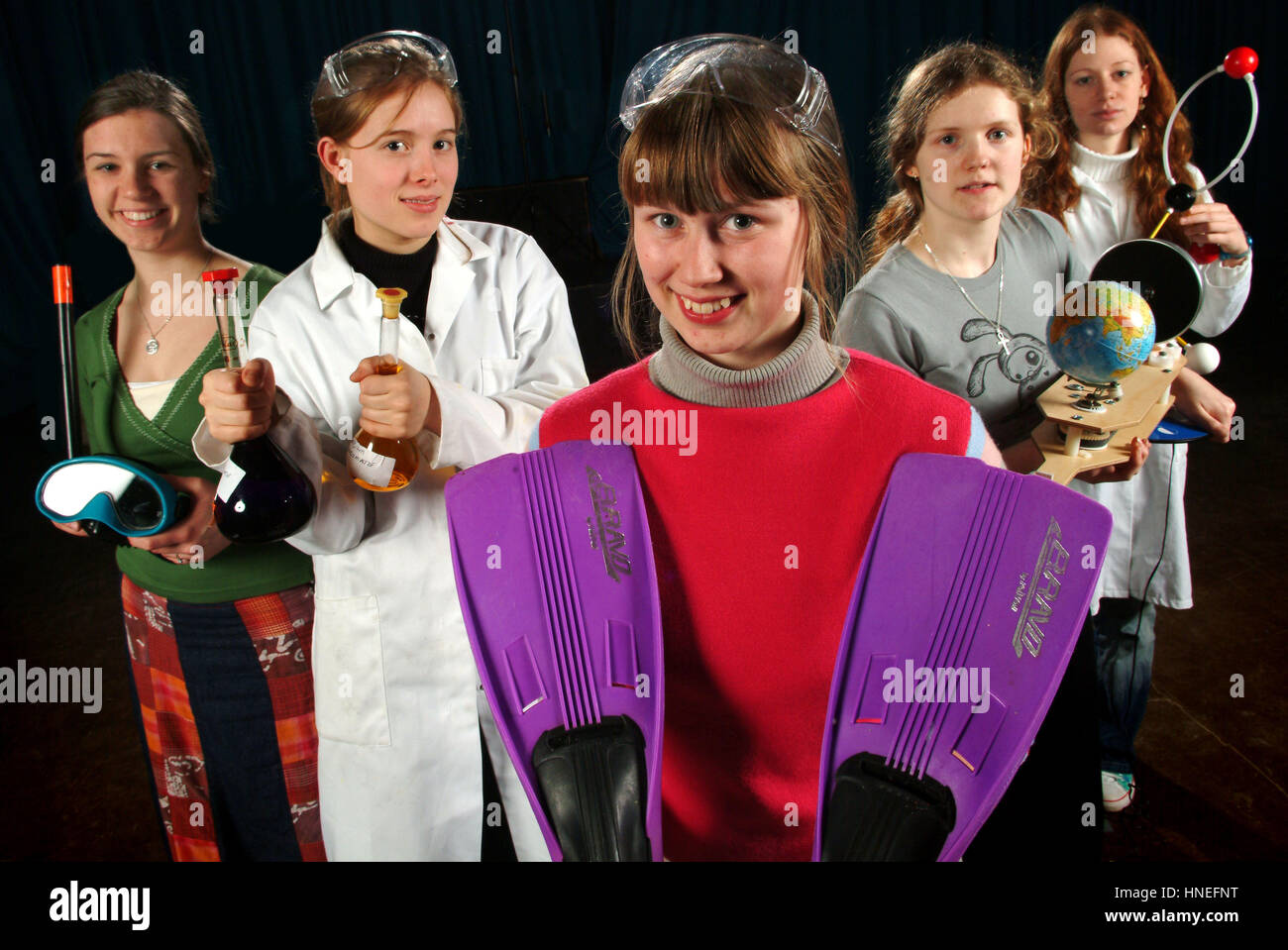 Girls at Rednock School, Dursley representing career choices including sports, science, chemist, geographer etc. - Stock Image
