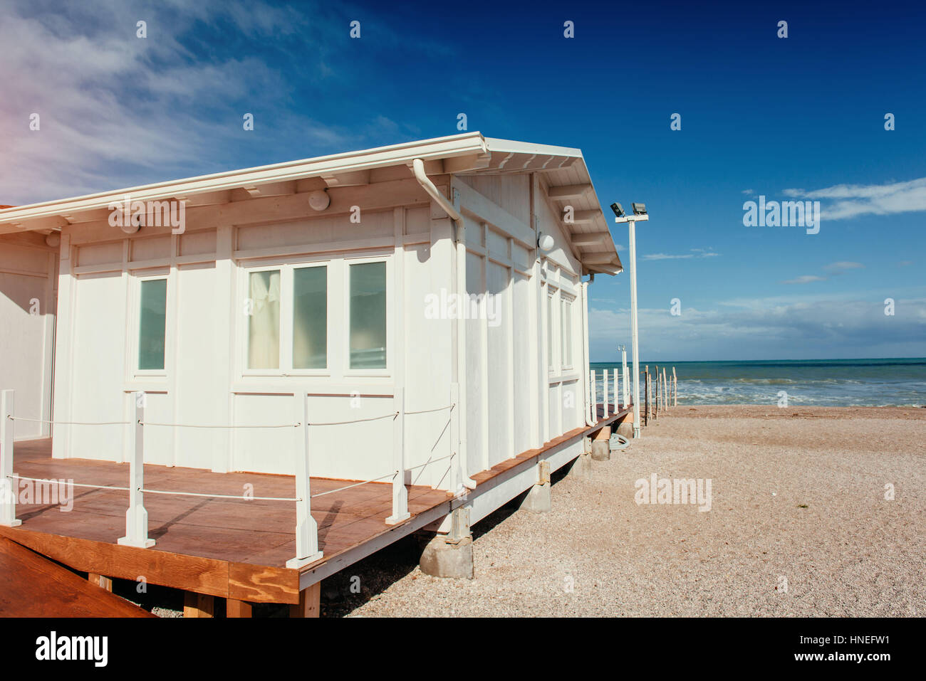 Small white cottage by the sea - Stock Image