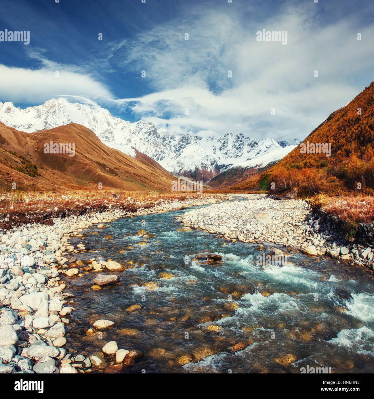 Snowy mountains and noisy mountain river - Stock Image