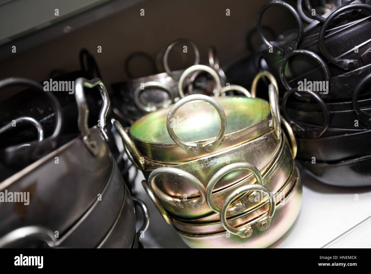 Stacked kitchen utensils in store - Stock Image