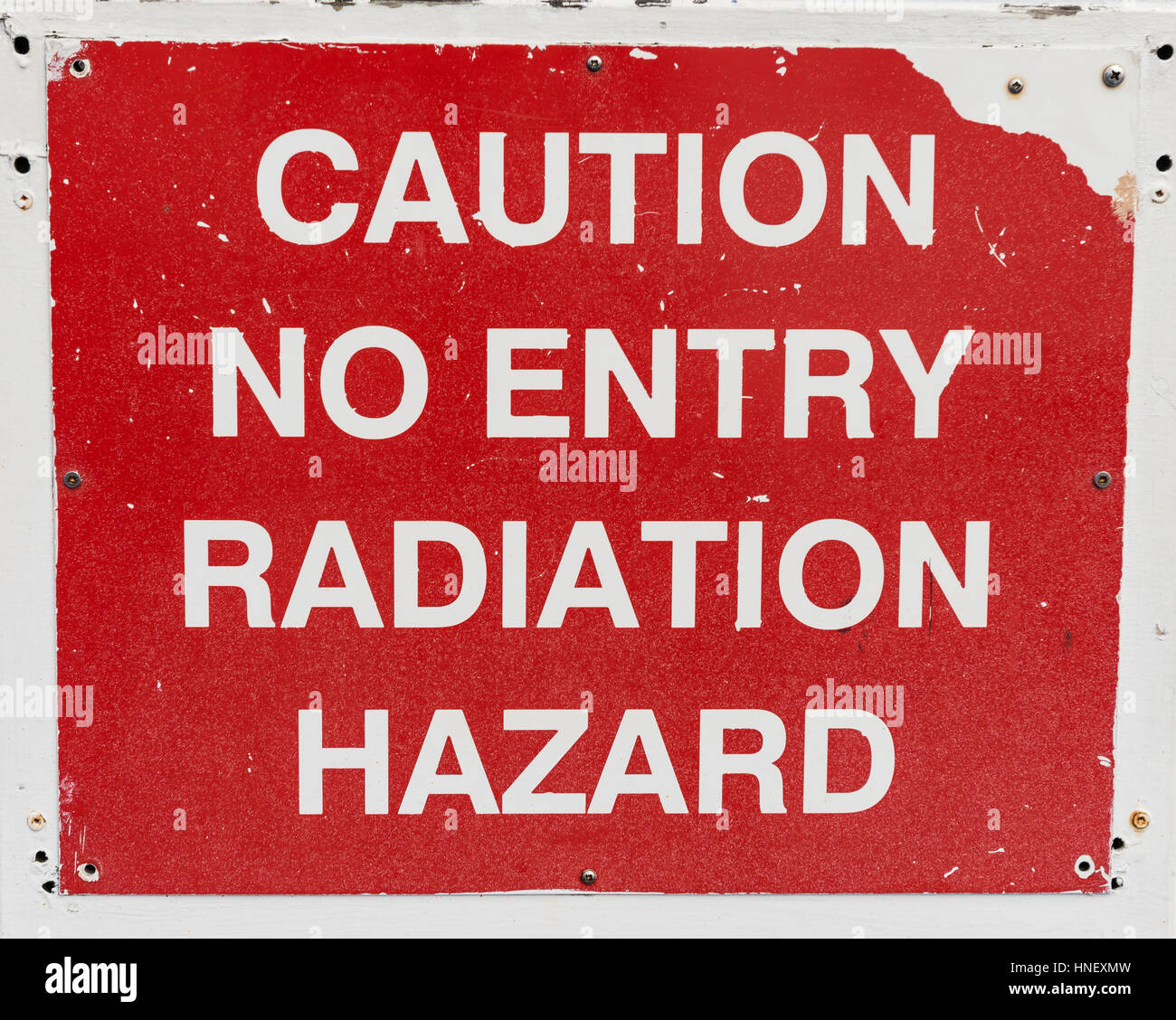 Lettering Caution no entry radiation hazard, warning sign against radiation - Stock Image