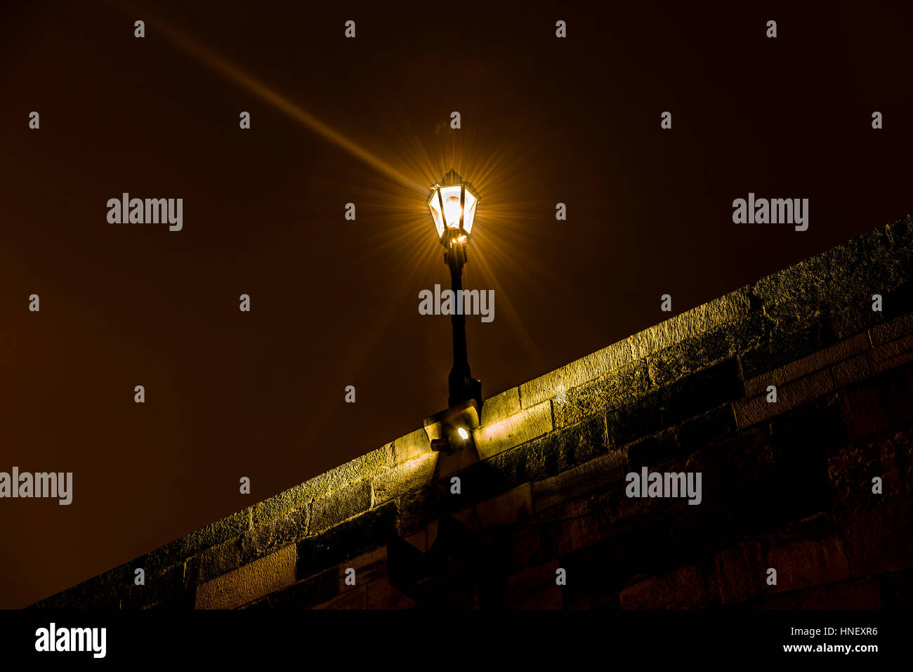 Old street lamp lit, Charles Bridge, Night Scene, historic centre, Prague, Bohemia, Czech Republic - Stock Image