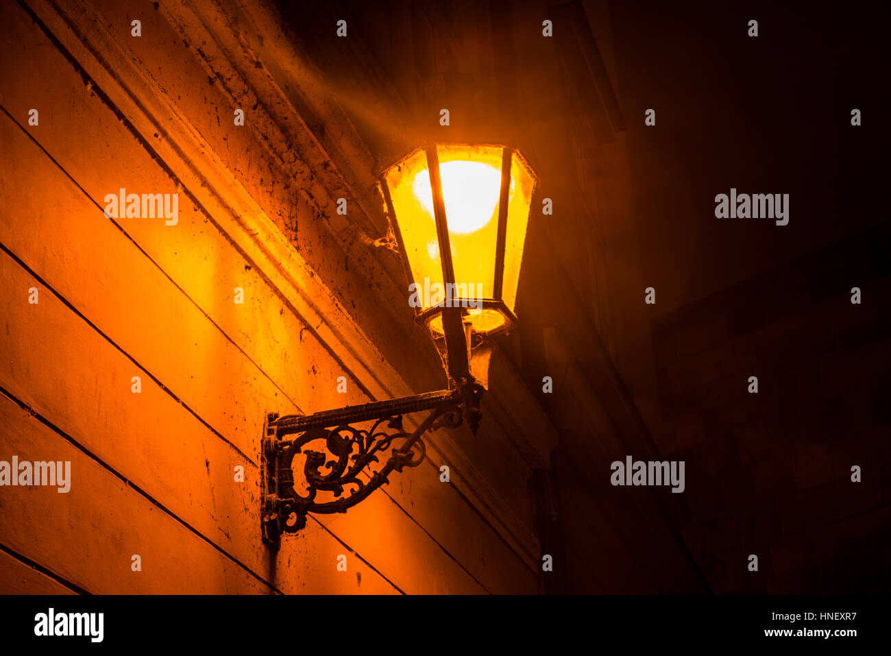 Old street lamp lit, night scene, historic centre, Prague, Bohemia, Czech Republic - Stock Image