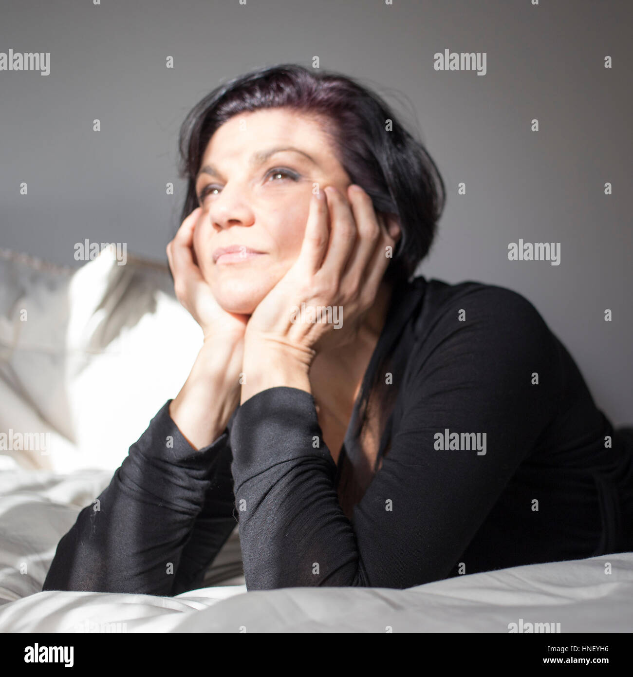 Unfocused shot of a dreaming woman - Stock Image