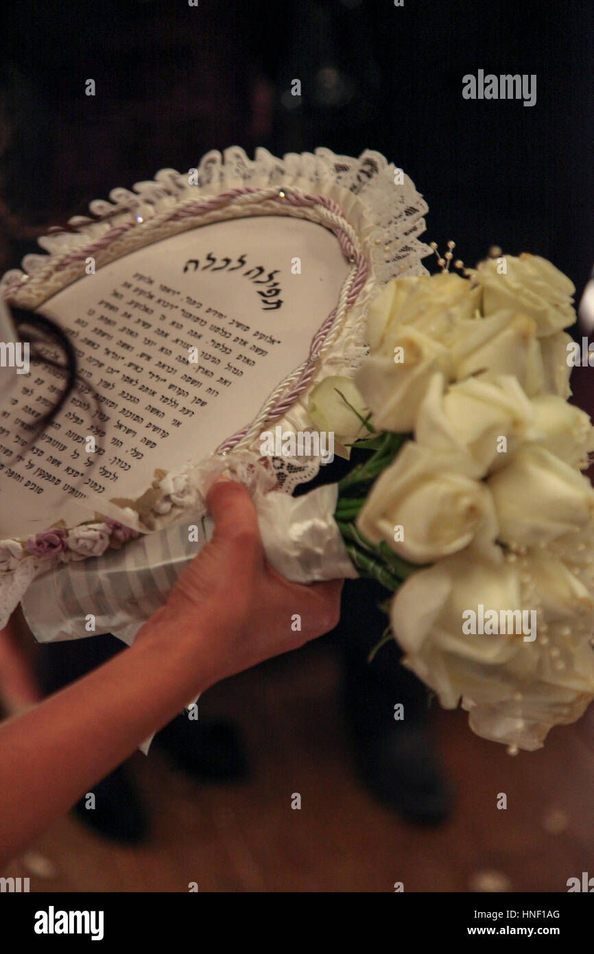 Bride's prayer. A bride on her wedding night reads a special prayer - Stock Image
