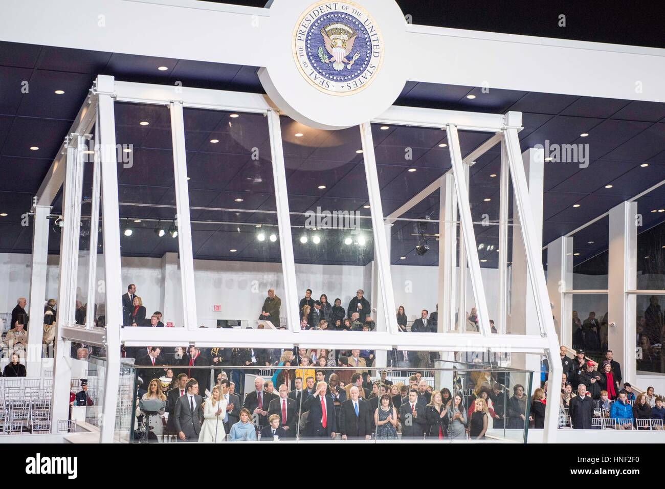 U.S. President Donald Trump and Vice President Mike Pence observe the 58th Presidential Inauguration Parade from - Stock Image