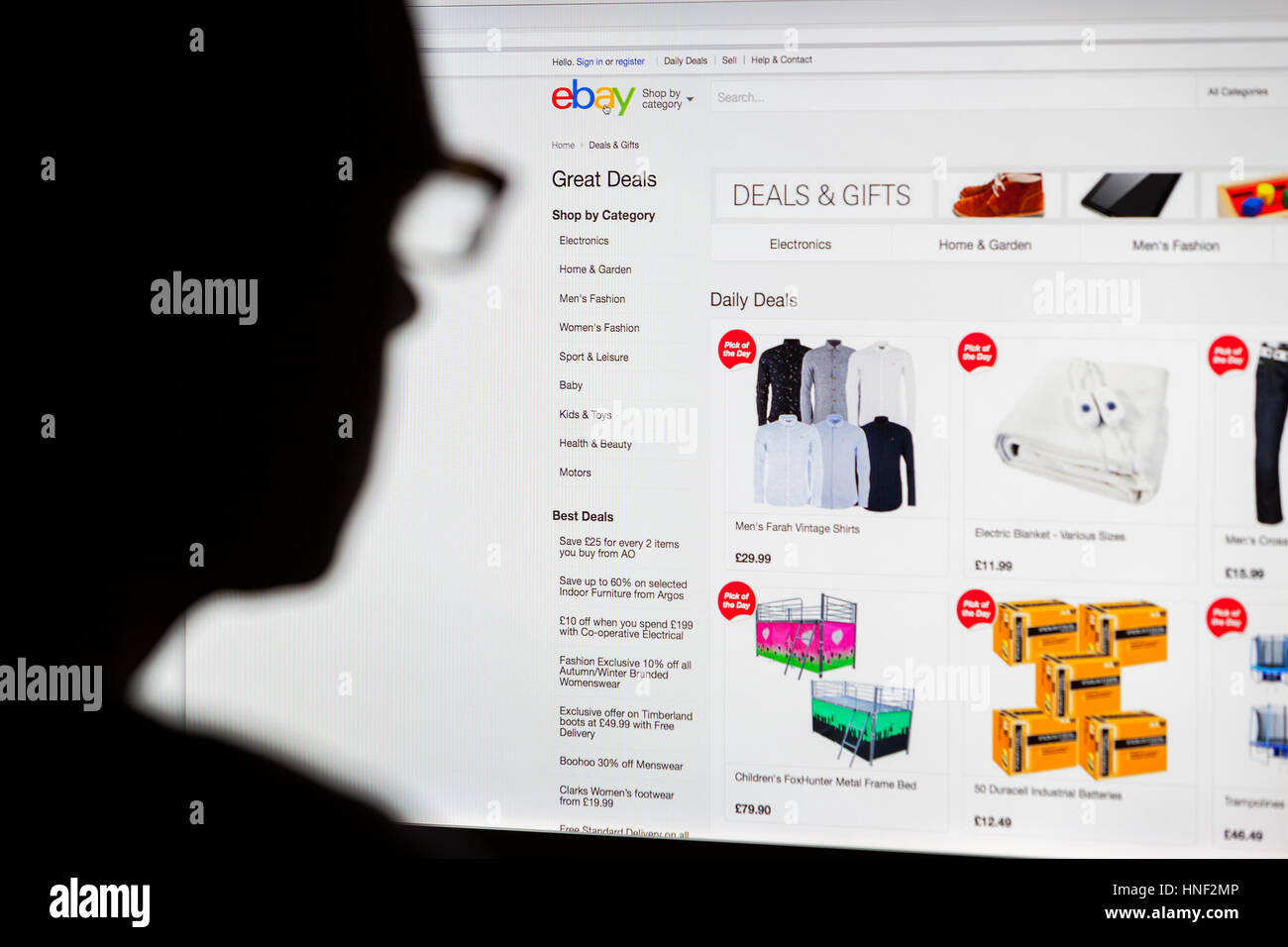 BATH, UK - SEPTEMBER 14, 2015: Close-up of the Ebay  homepage displayed on a LCD computer screen with the silhouette - Stock Image