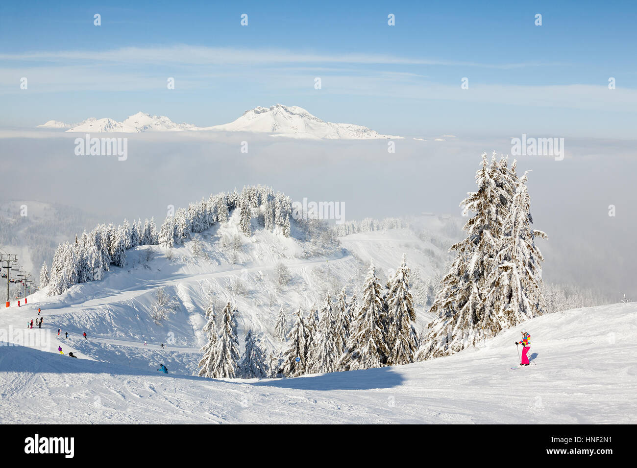MORZINE, FRANCE - FEBRUARY 06, 2015: Skiers and snow boarders on Le Ranfoilly mountain peak in Les Gets ski resort - Stock Image