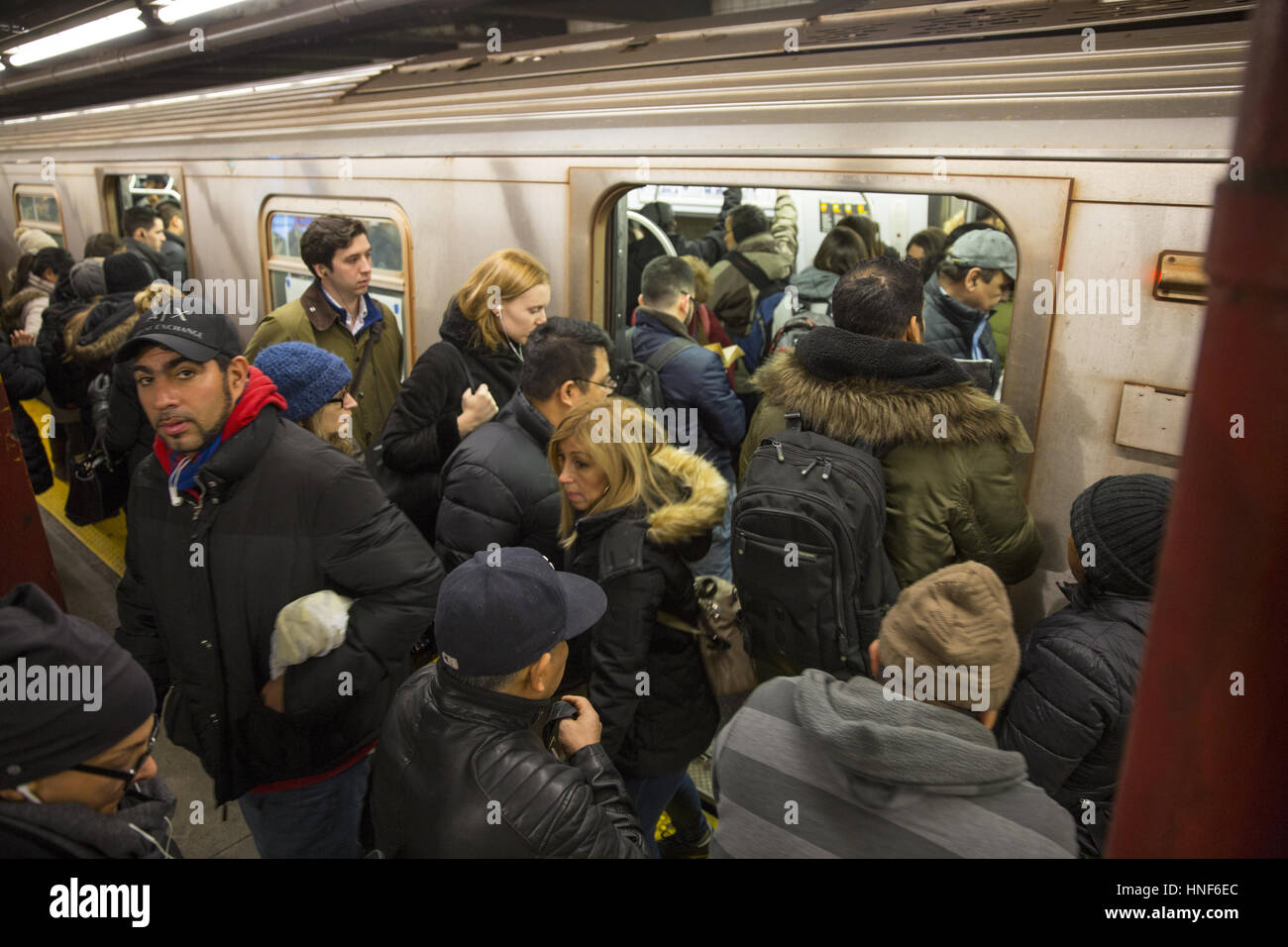 Crowded subway  platform, at 47-50th Sts. Rockefeller Center during the evening rush hour in midtown Manhattan. - Stock Image