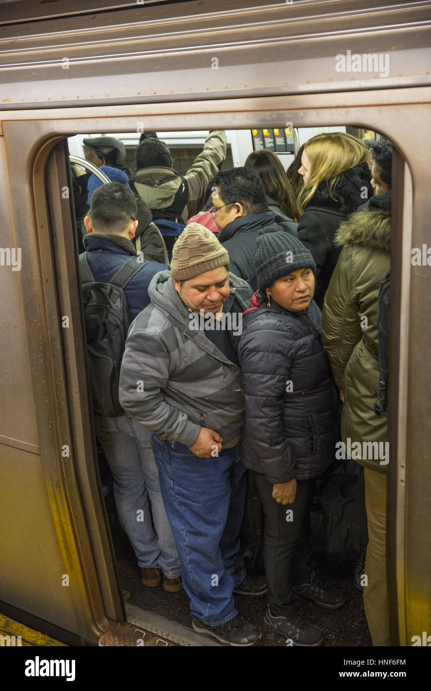 Pack subway car on the station platform platform, at 47-50th Sts. Rockefeller Center during the evening rush hour - Stock Image