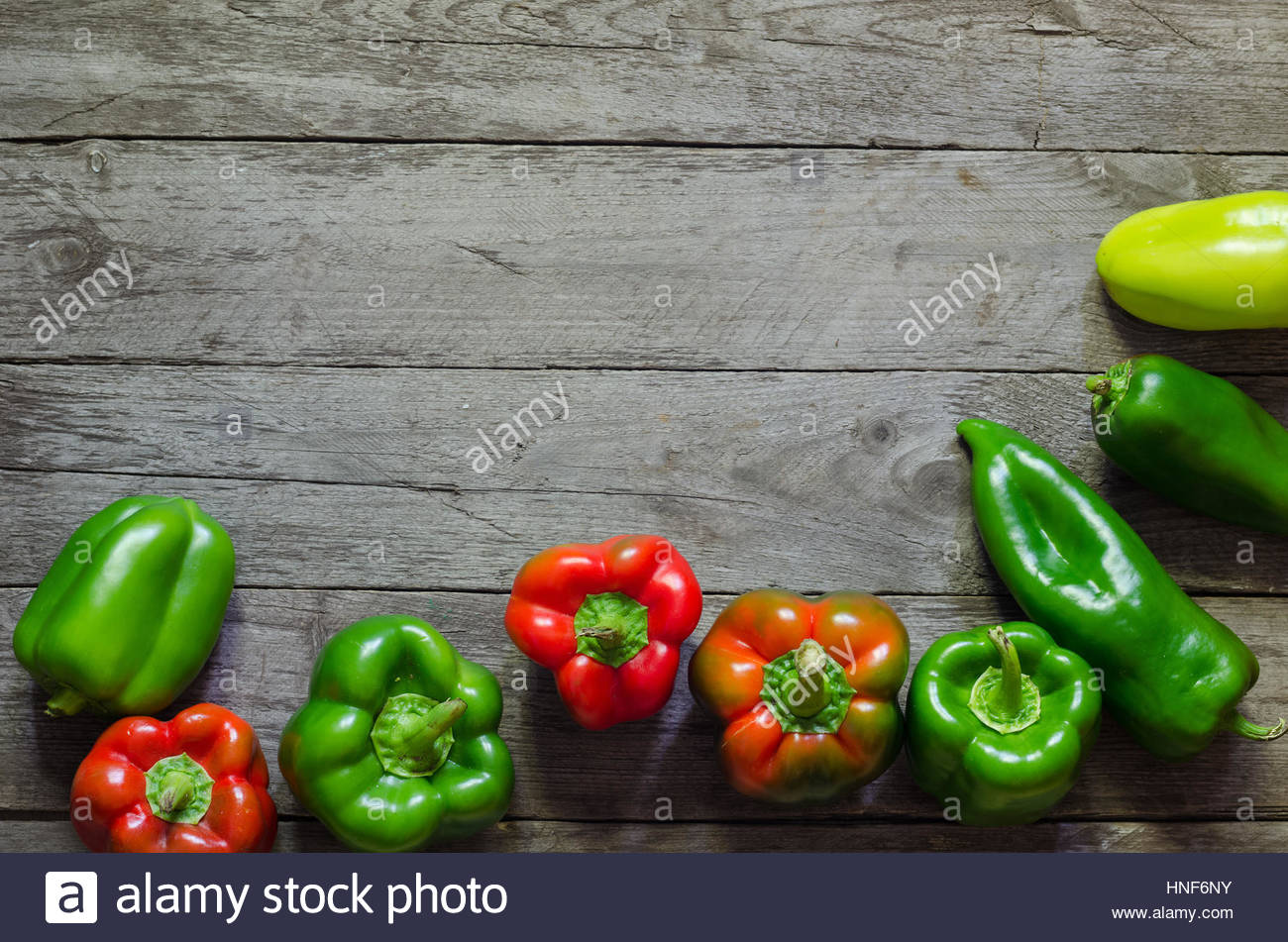 Fresh red pepper on wooden background, selective focus Stock Photo