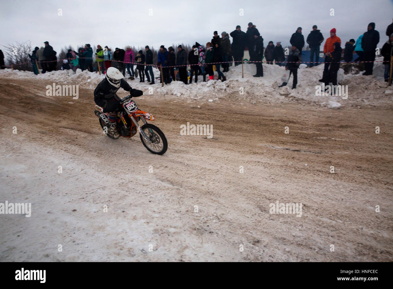 Sportsmen on sport motorcycles pass the track during the winter motocross competitions during the 'Winter Fun' - Stock Image