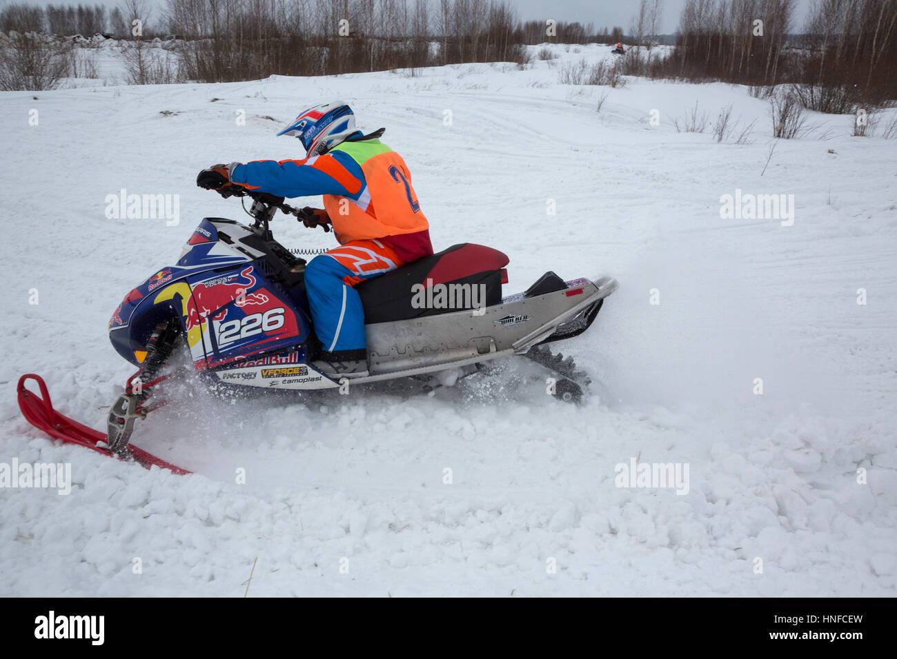 A sportsman takes part in the Volga Cup on snowmobile sport during the Winter Sports Festival in Uglich, Russia - Stock Image