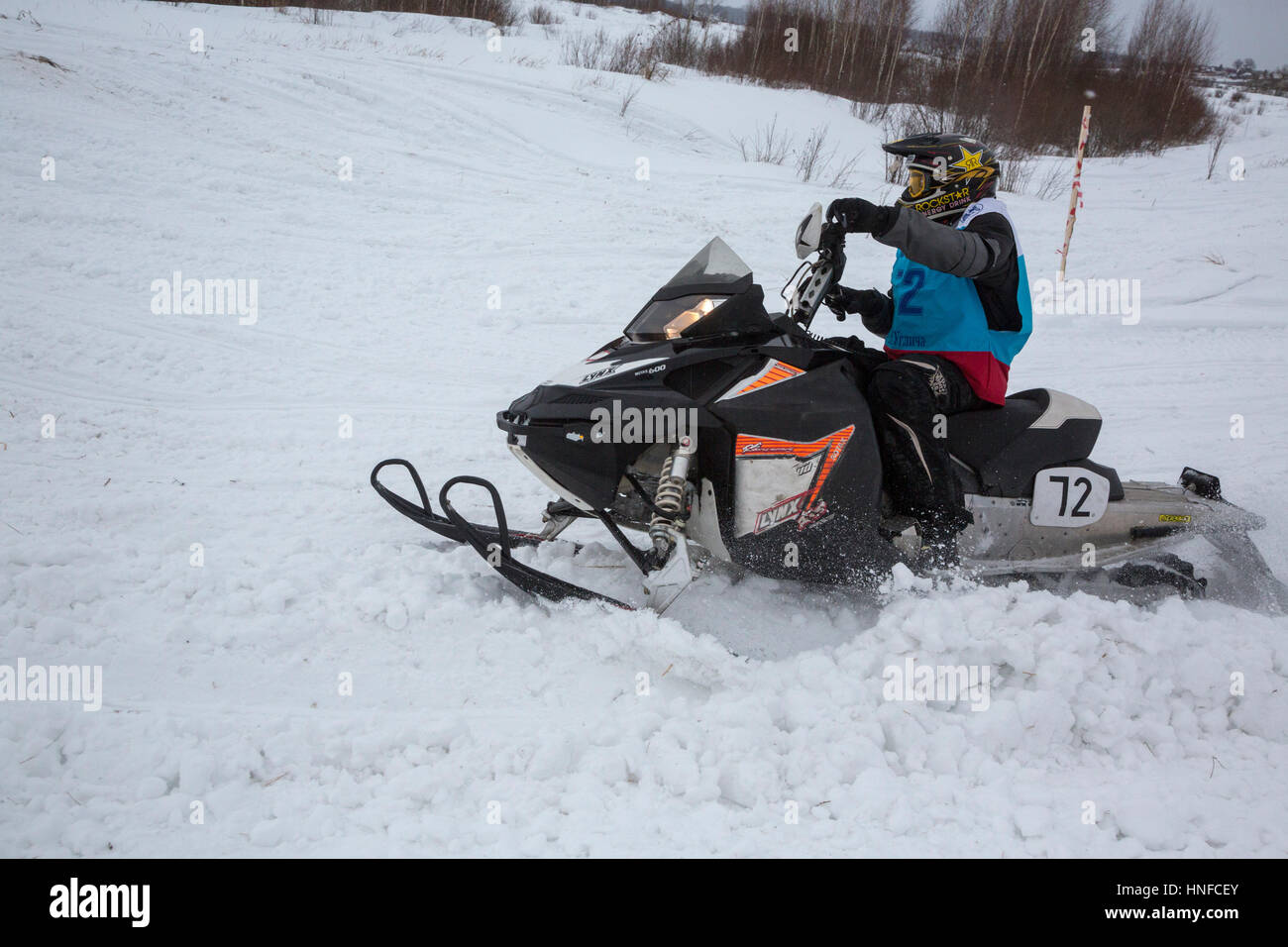 A sportsman takes part in the Volga Cup on snowmobile sport during the Winter Sports Festival in Uglich, Russia Stock Photo