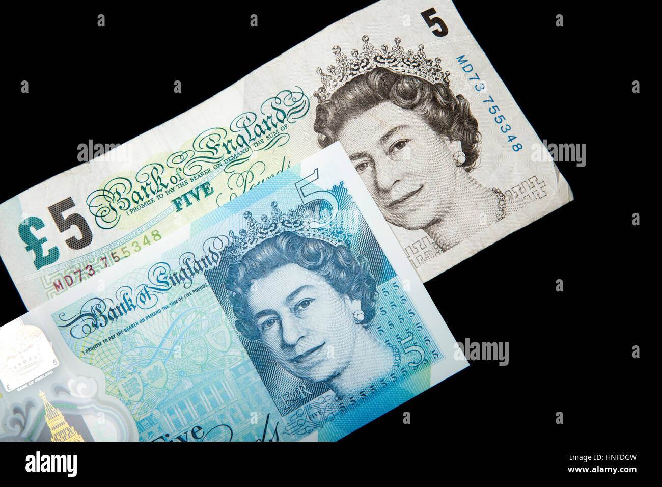New polymer 5 pound note next to the old paper note - Stock Image