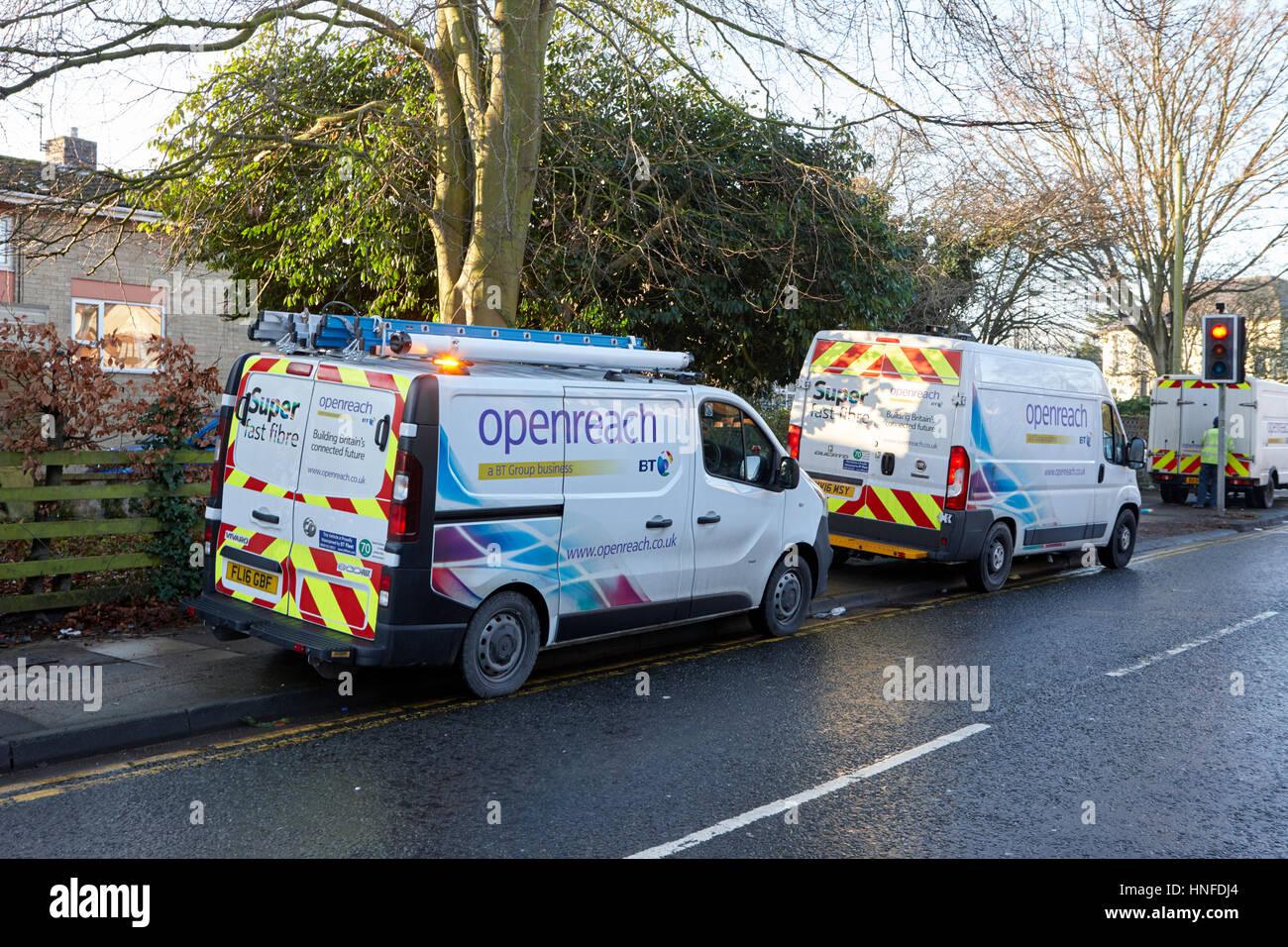 bt openreach vans parked by the roadside to fix a fault in the broadband network liverpool uk - Stock Image