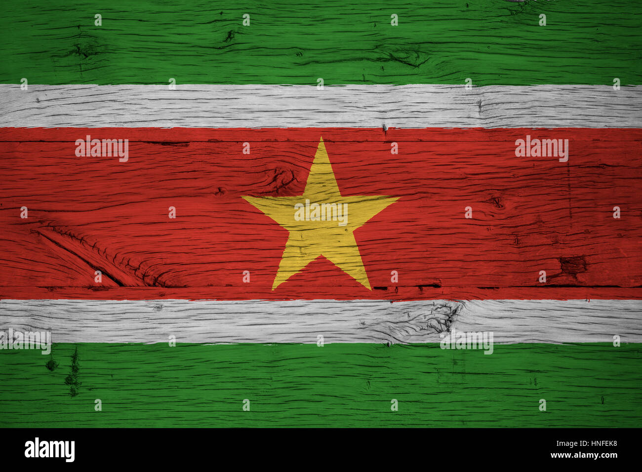Suriname national flag painted on old oak wood. Painting is colorful on planks of old train carriage. - Stock Image