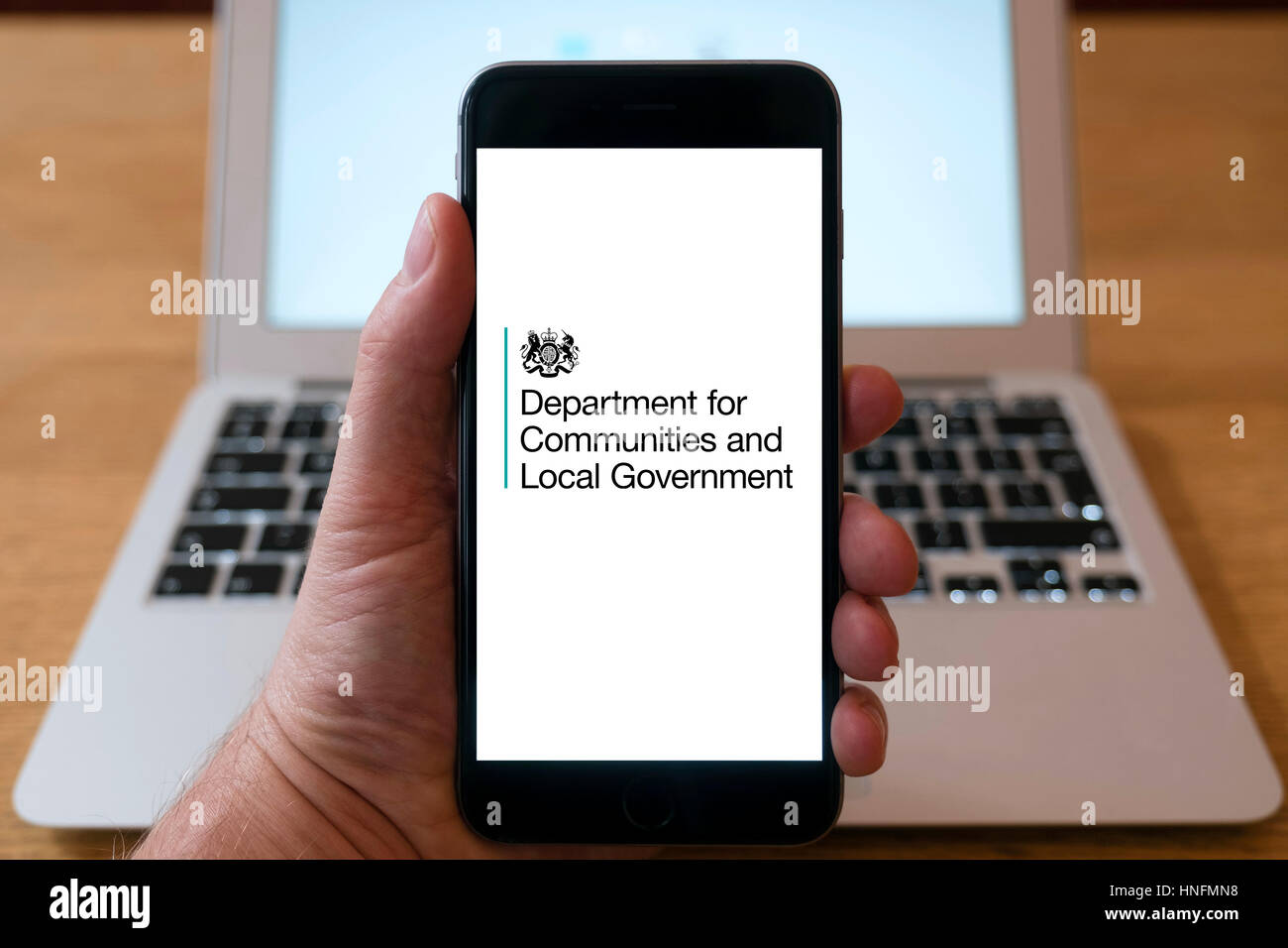 Logo for UK Government Department for Communities and Local Government on smart phone screen. - Stock Image