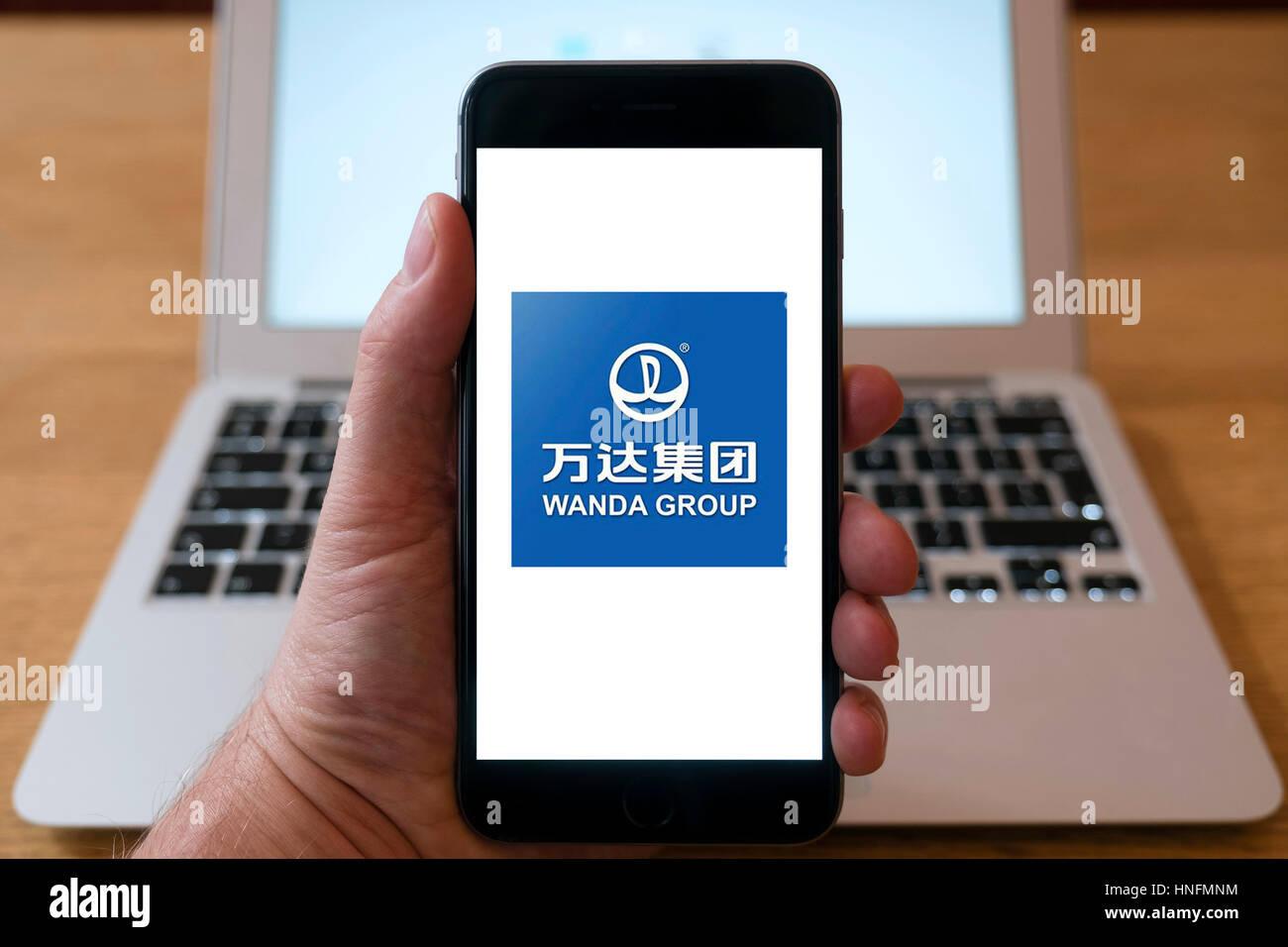 Chinese Wanda Group multinational conglomerate corporation logo on smart phone screen. - Stock Image
