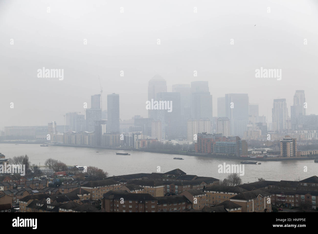 London, UK. 12th February, 2017. UK Weather: Fog over London and Canary Wharf business park buildings © Guy Corbishley/Alamy Stock Photo