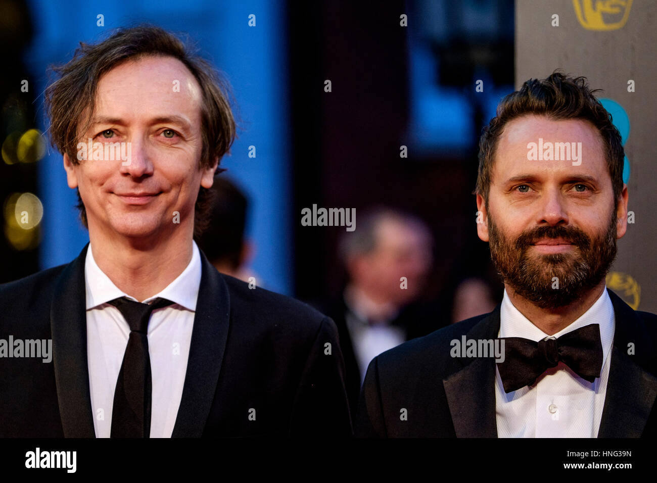 London, UK. 12th February 2017. Volker Bertelmann and Dustin O'Halloran arrives at the EE British Academy Film - Stock Image