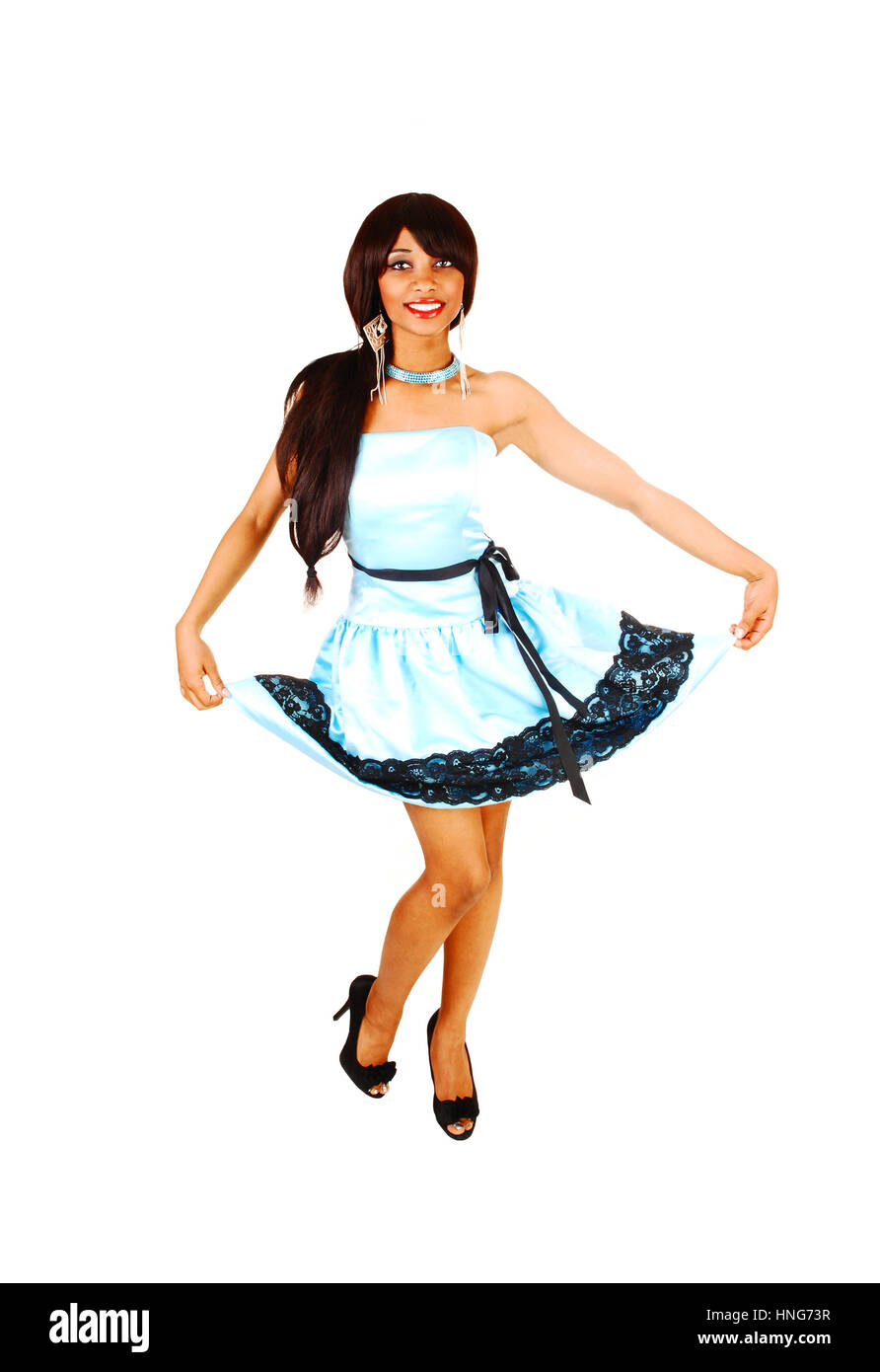 009713486c7 A happy beautiful teenager in her blue satin prom dress