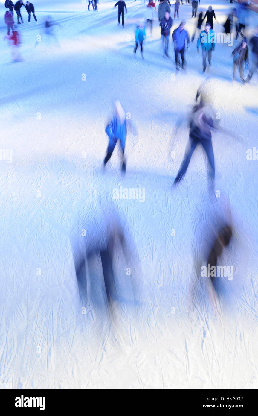 Motion blur of people skating on ice. - Stock Image