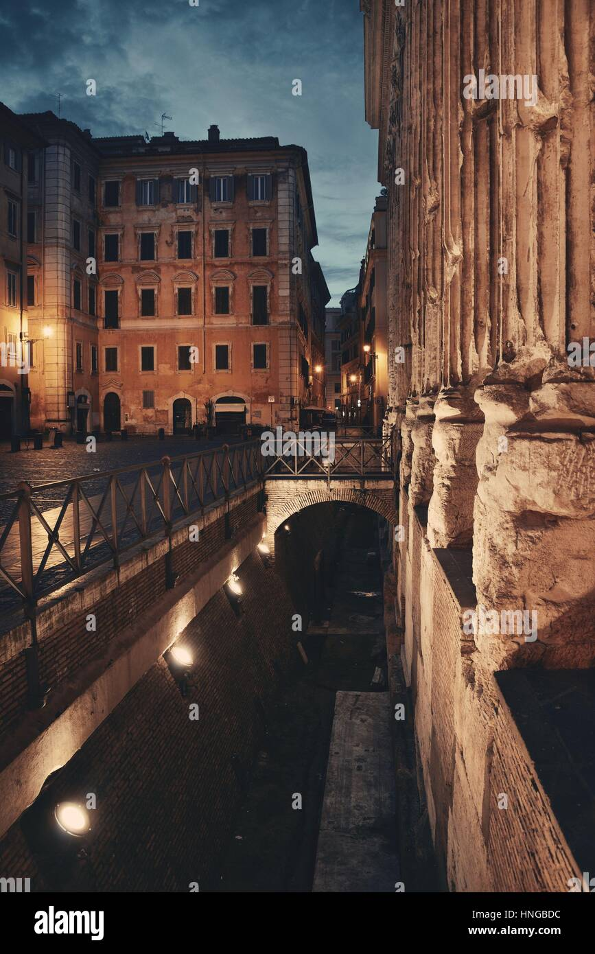Street view with historical buidings and ruins in Rome, Italy. - Stock Image