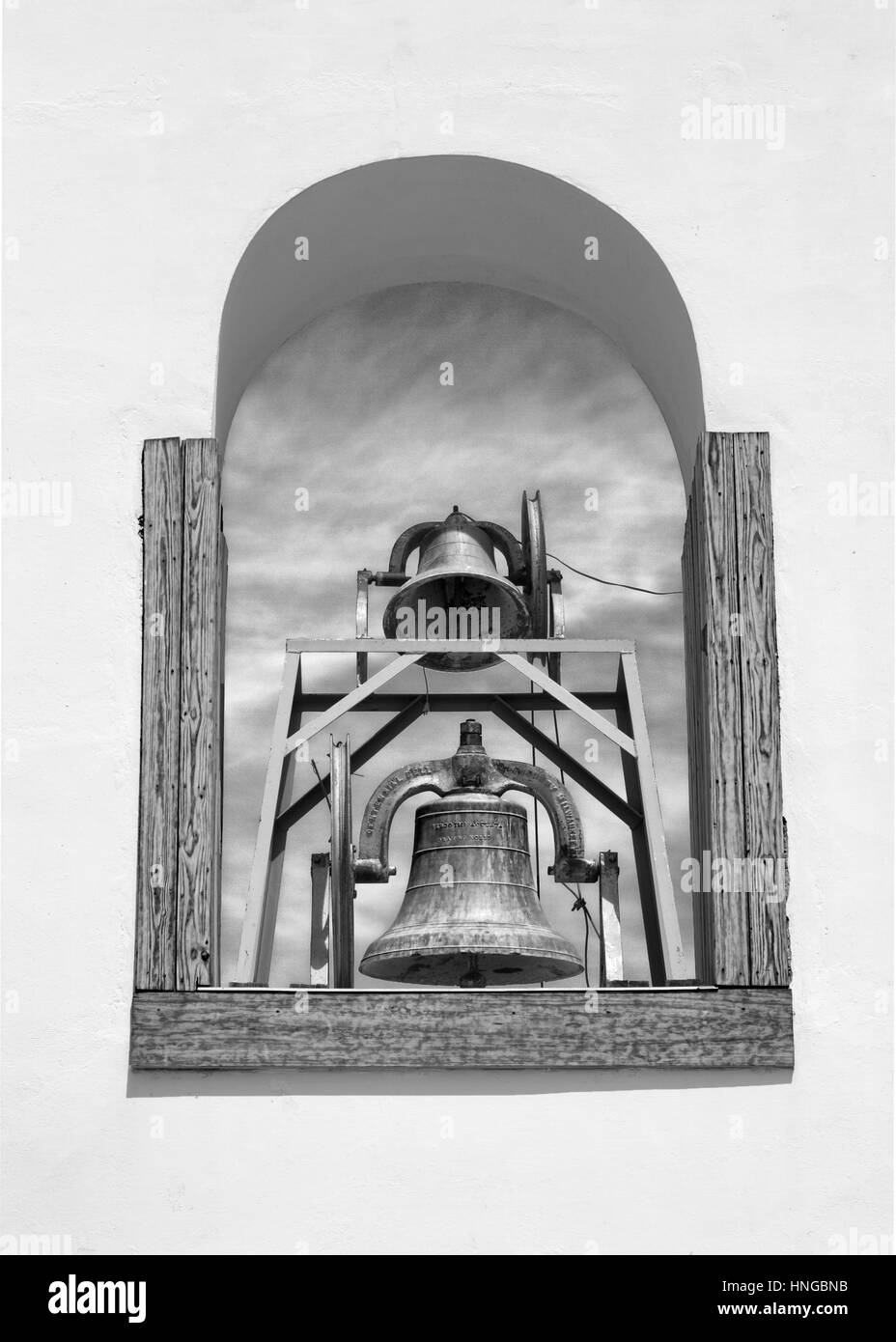 The bells of the Spanish Mission bell tower in Texas. - Stock Image
