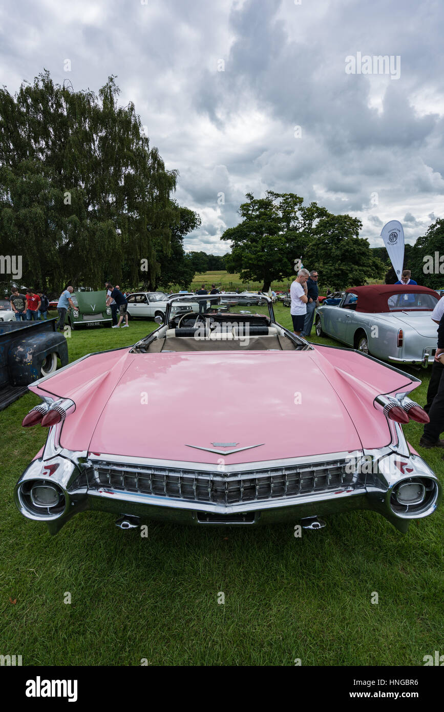 Huge boot and elaborate wings on a pink 1959 Cadillac Eldorado at the Bodelwyddan Classic Car Show Stock Photo