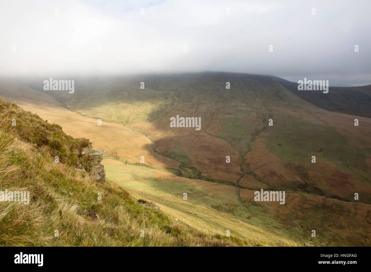 The Path Along the Escarpment. A public walking path goes along the escarpment of Craig y Fan Ddu in the Brecon - Stock Image