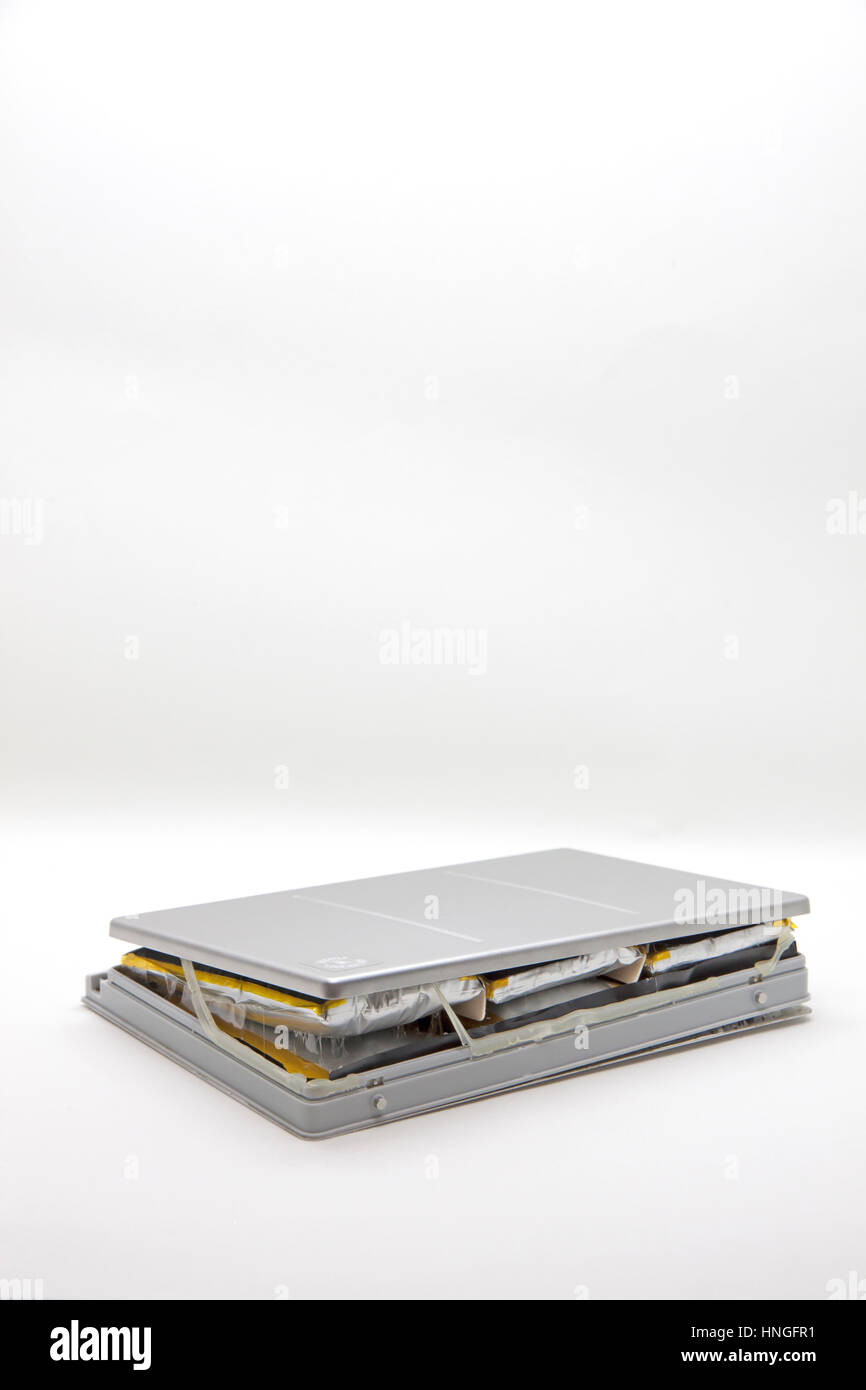 Exploded Macbook laptop battery. - Stock Image