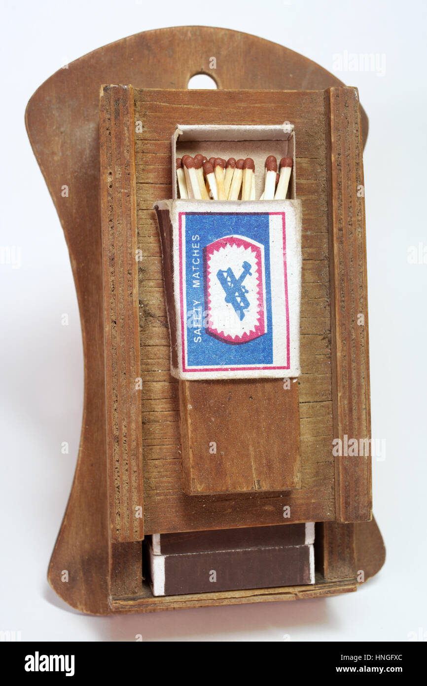 The old-fashioned way of storing the matches in an antique fixture - Stock Image