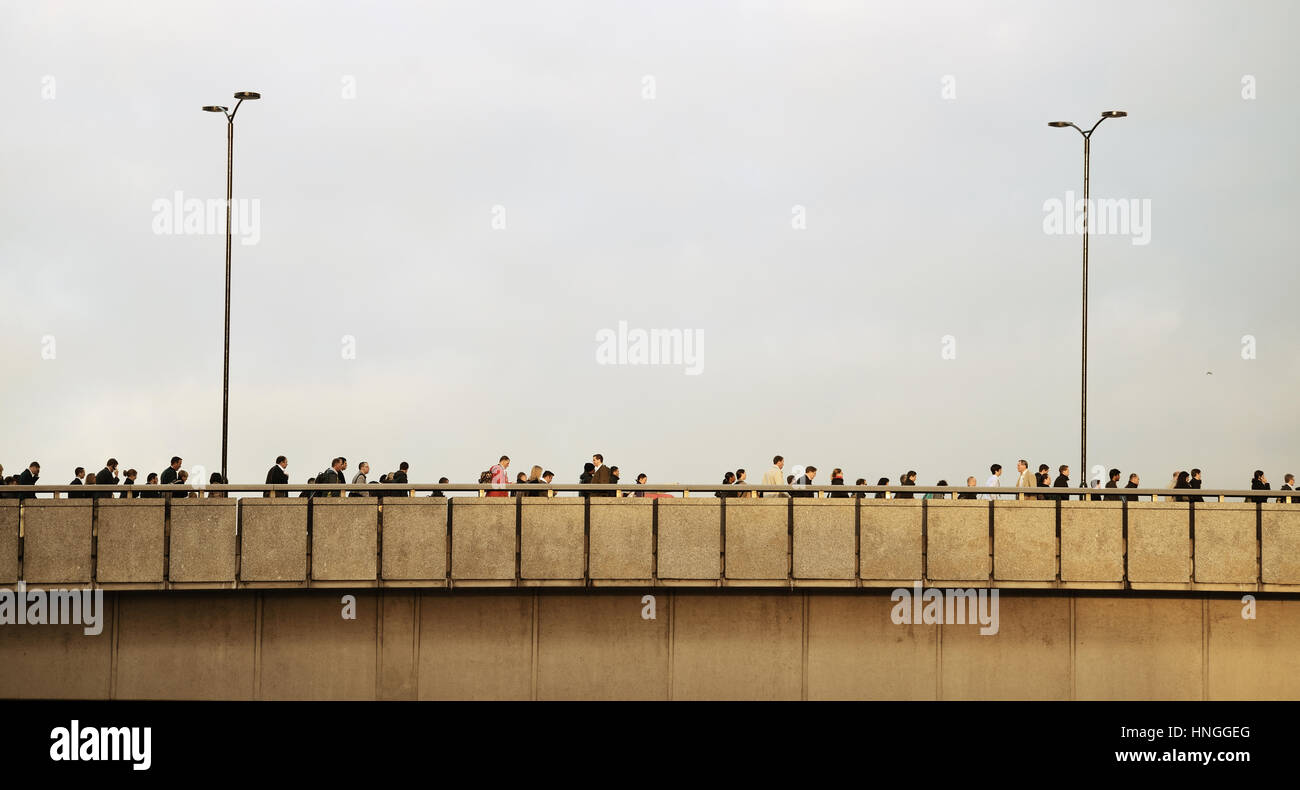 LONDON, UK - SEP 27: Morning commute on bridge on September 27, 2013 in London, UK. London is the world's most - Stock Image
