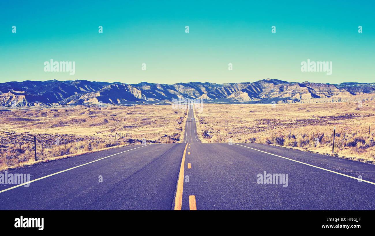 Vintage toned desert asphalt road, moving forward concept, USA. - Stock Image