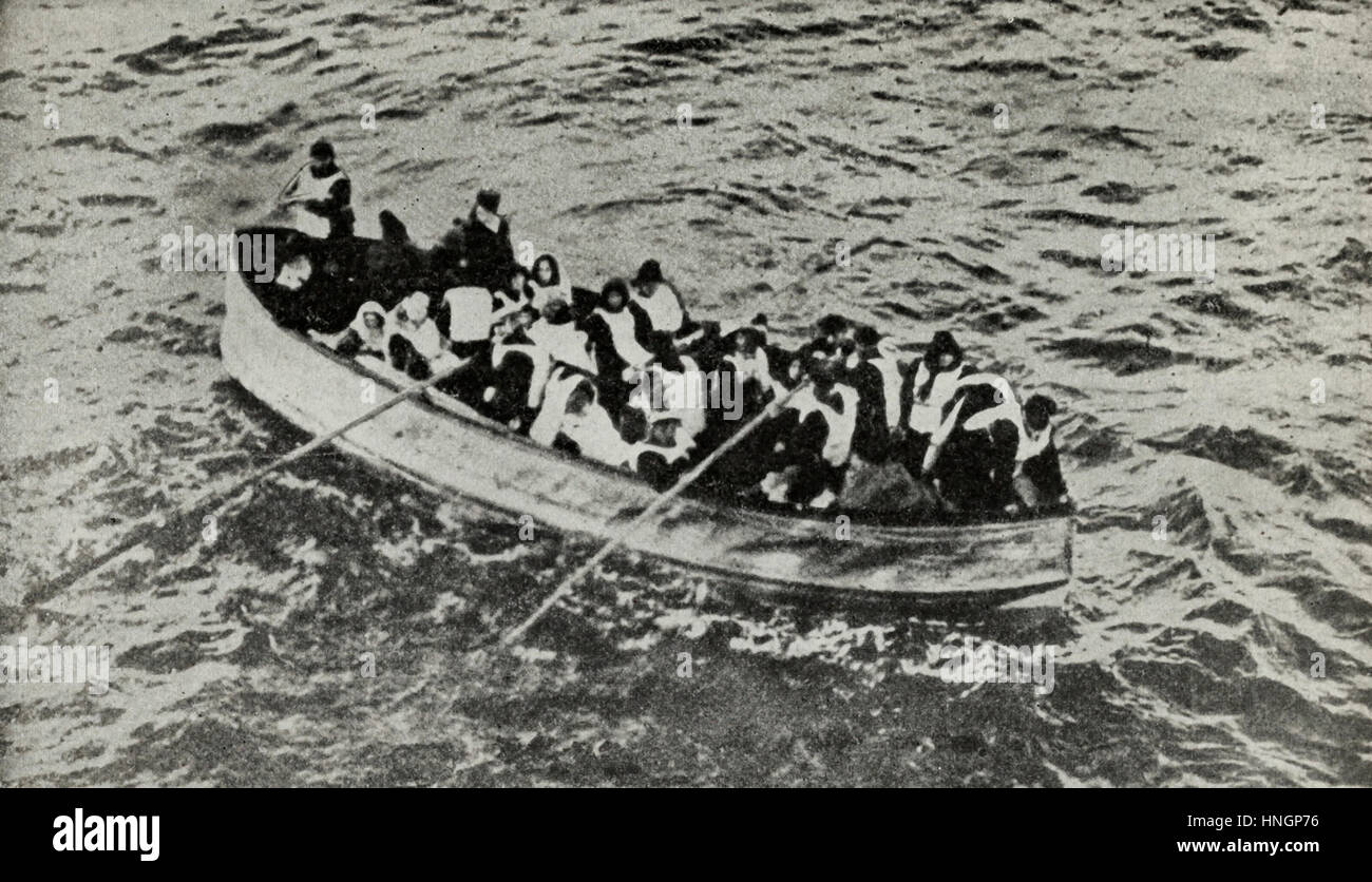 All eyes on the Rescue Ship - Survivors of the Titanic in one of her collapsible lifeboats, just before being picked - Stock Image